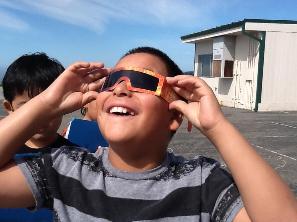 boy with solar glasses