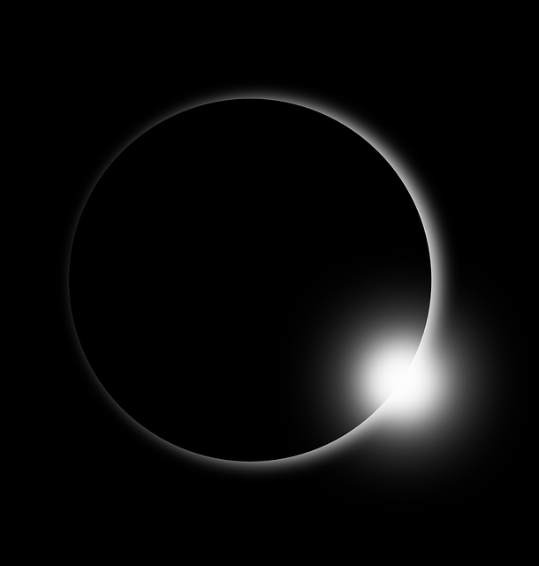 white ring of sun's corona against black space