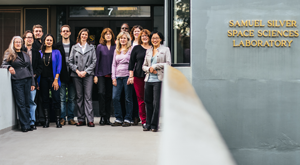 group of smiling people outside a Lab