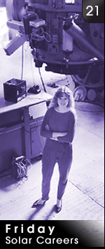 woman in front of large telescope