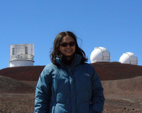 woman outdoors with observatories behind her